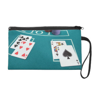 Cards and chips on betting table wristlet purse