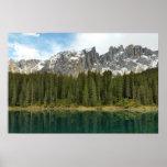 Carezza lake and surrounding mountains poster