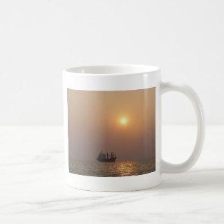 Cargo Ship Under A Hazy Sun Coffee Mug