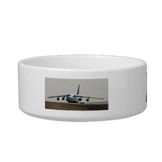 cargolifter plane in airport cat food bowl