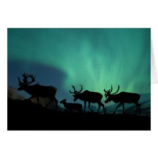 Caribú y aurora boreal tarjeta de felicitación