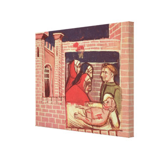 Caring for an injured man in a castle canvas print