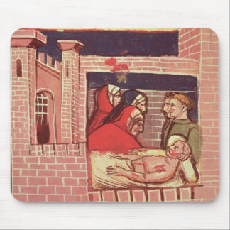Caring for an injured man in a castle mouse pad