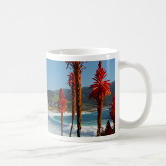 Carmel Point beach with Torch Aloe flowers Coffee Mug