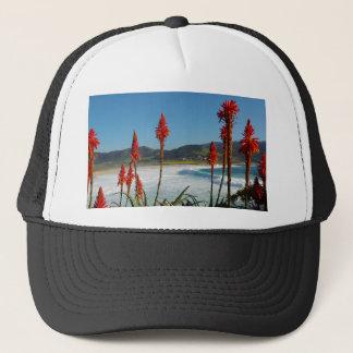 Carmel Point beach with Torch Aloe flowers Trucker Hat