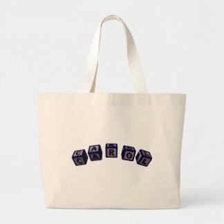 Carol toy blocks in blue tote bag