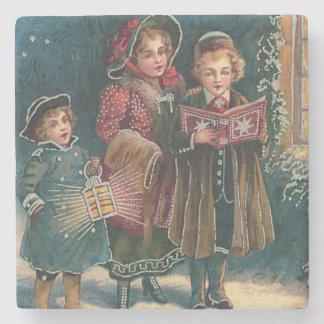 Carolers lindos Caroling de los niños Posavasos De Piedra