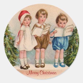 Caroling embroma a los pegatinas de las Felices Etiquetas Redondas