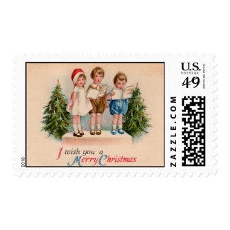 Caroling Kids Merry Christmas Postage Stamp
