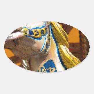 Carousel horse on merry goround oval sticker
