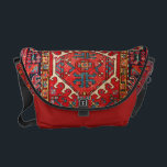 """Carpet-bag style, from print of vintage carpet, courier bag<br><div class=""""desc"""">A modern take on the traditional carpet bag, so popular in the 19th Century! A photo of a beautiful handmade vintage carpet in its original colors. The pattern woven into the original vintage carpet is in the traditional warm colors used, with red and scarlet dominating, and gold and duck-egg blue...</div>"""