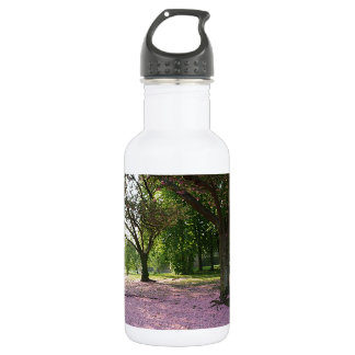 Carpet of prunus pink flowers water bottle
