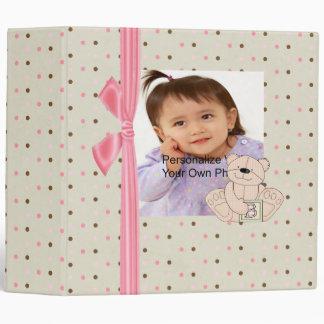 Carpeta beige y rosada de la foto del bebé