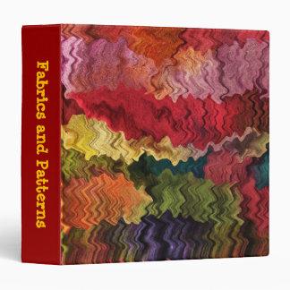 Carpeta colorida del extracto de la tela