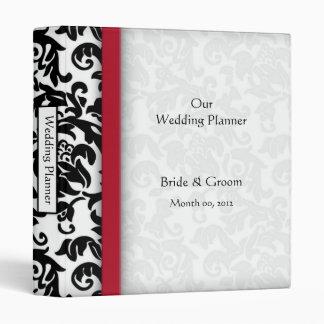 Carpeta roja y negra del planificador del boda del