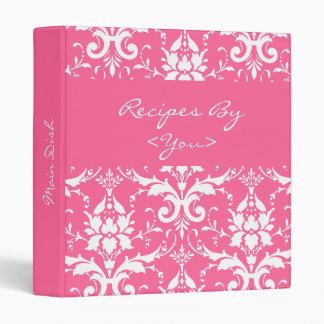 Carpeta rosada y blanca del libro del cocinero de