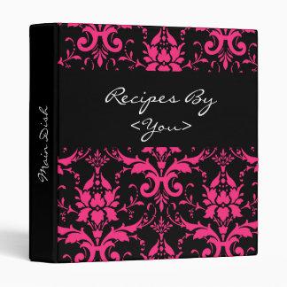 Carpeta rosada y negra del libro del cocinero de