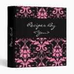 Carpeta rosada y negra del libro del cocinero de l
