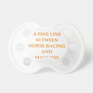 carrera de caballos chupete de bebé