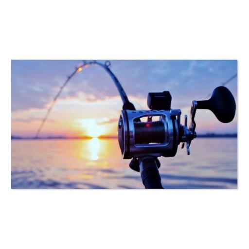 Carrete de la pesca en la puesta del sol tarjeta de negocio