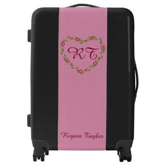 Carretilla negra y rosada del equipaje del maletas