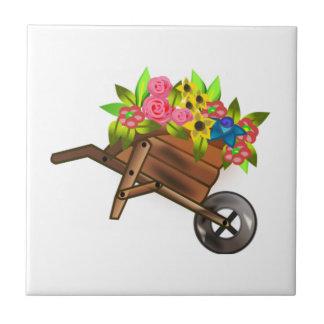 Carretilla por completo de flores teja cerámica