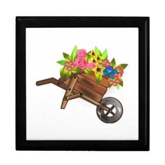 Carretilla por completo de flores cajas de regalo