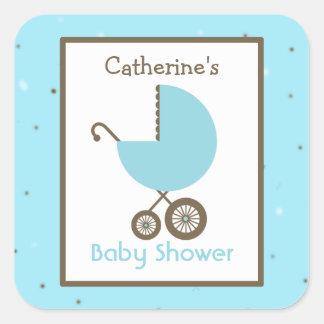 Carro azul de la fiesta de bienvenida al bebé y el etiquetas