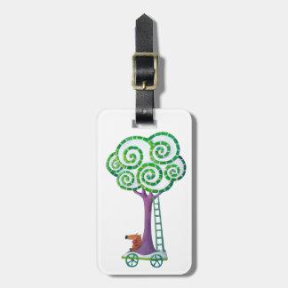 Carro con el árbol mágico etiquetas maletas