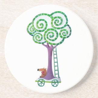 Carro con el árbol mágico posavaso para bebida