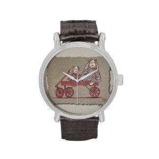 Carro, conejo y muñecas rojos relojes