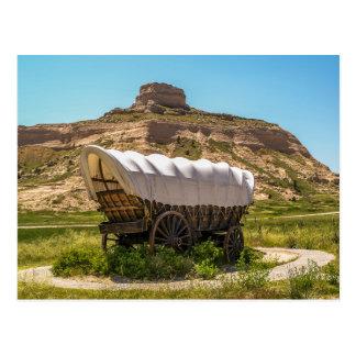 Carro cubierto en el monumento nacional del tarjeta postal