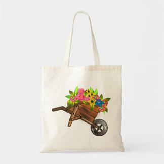 Carro de la carretilla llenado de las flores bolsa