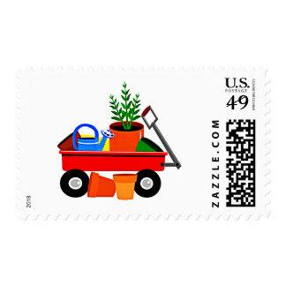 Carro rojo con las plantas y los utensilios de estampillas