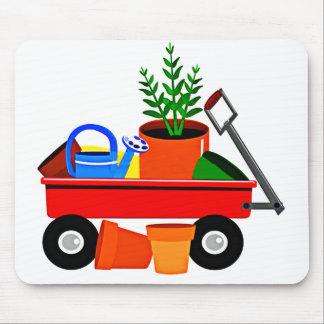 Carro rojo con las plantas y los utensilios de jar tapetes de raton