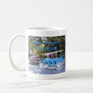 Carro traído por caballo tazas de café
