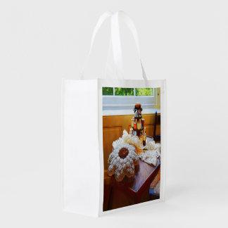 Carrusel y cordón del hilo bolsas para la compra
