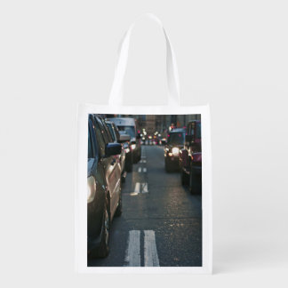Cars lie in wait at a stoplight reusable grocery bag