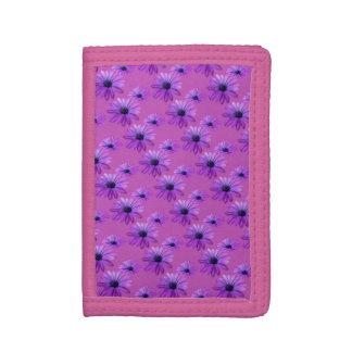 Carteras azules de la flor de la margarita púrpura
