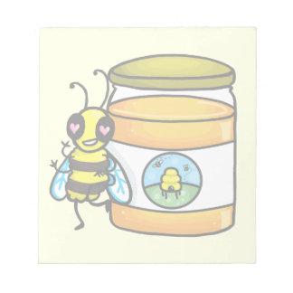 Cartoon bee leaning on honey jar memo notepads