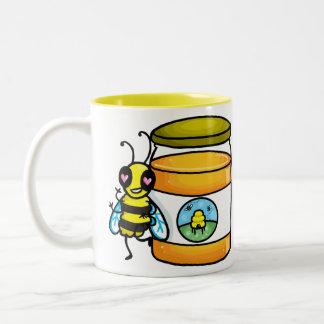 Cartoon bee leaning on honey jar Two-Tone coffee mug