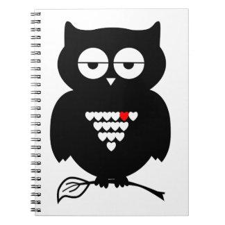 Cartoon Black Owl on Notebook