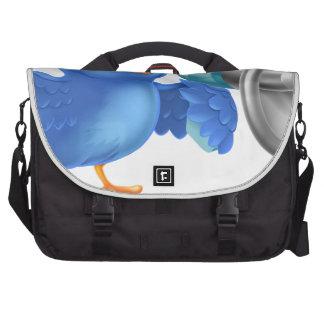 Cartoon blue bird with mega phone laptop bags