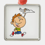 cartoon boy playing with toy airplane christmas ornament