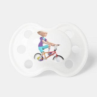 Cartoon Boy Riding A Bike Pacifier