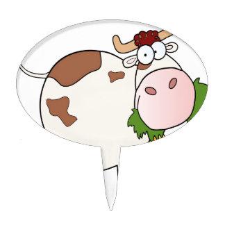 Cartoon cow eating grass cake topper