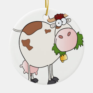 Cartoon cow eating grass ceramic ornament