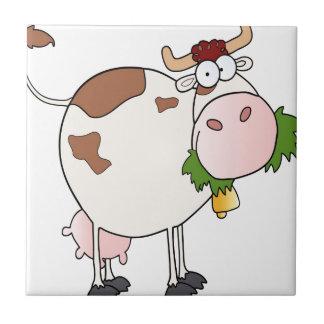 Cartoon cow eating grass ceramic tile