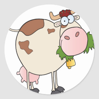 Cartoon cow eating grass classic round sticker
