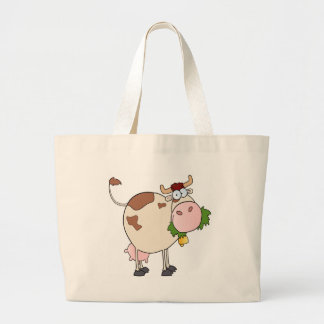 Cartoon cow eating grass large tote bag